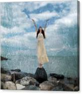 Woman By The Sea With Arms Reaching Up In Praise Canvas Print