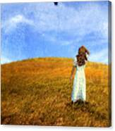 Woman In Field Looking Up At An Airplane Canvas Print