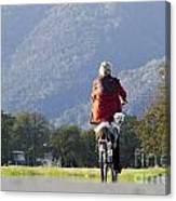 Woman On A Bicycle With Her Dog Canvas Print