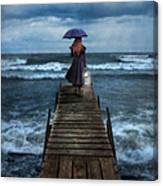 Woman On Dock In Storm Canvas Print