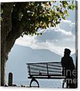Woman Sitting On A Bench Canvas Print