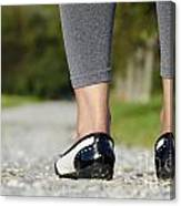 Woman Standing On A Stone Road Canvas Print