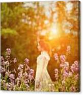 Woman Staning Sideways In Garden At Sunset Canvas Print