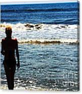 Woman Walking Into Ocean Surf  Canvas Print