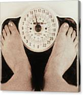 Woman's Feet On A Set Of Weighing Scales Canvas Print