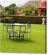 Wrought Metal Chairs Around A Table In A Lawn Canvas Print
