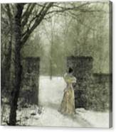 Young Lady By Stone Pillar In Snow Canvas Print
