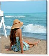 Young Woman Sitting On A Beach Canvas Print