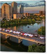 A Beautiful Sunset Falls On The Austin Skyline As Thousands Of Bat Watchers Line The Congress Avenue Bridge During The Annual Bat Fest To Watch The Bats Take Flight Canvas Print