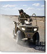 A U.s. Soldier Performs Off-road Canvas Print