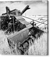 Abondoned Combine In Tall Grass Canvas Print