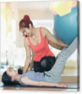 Asian Woman Fitness Coach Teach Her Student For Rubber Ball Exer Canvas Print
