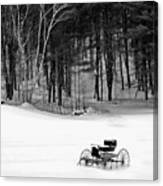 Carriage In A Field Of Snow Canvas Print