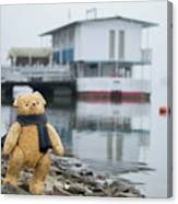 Cheerful Teddy Bear In Knitted Scarf Stand By The Riverside Beside The Port Canvas Print