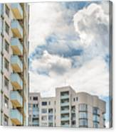 Clouds And Buildings Canvas Print