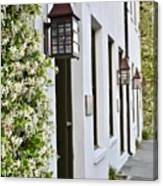 Colonial Home Exterior With Vertical Plants And Old Lanterns Displayed On The Side Of Home Canvas Print