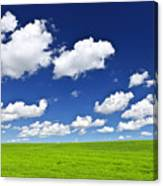 Green Rolling Hills Under Blue Sky Canvas Print