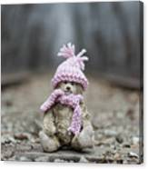Little Teddy Bear Sitting In Knitted Scarf And Cap In The Winter Forest Between The Rails Canvas Print