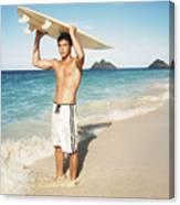 Man At The Beach With Surfboard Canvas Print