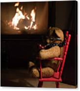 Old Teddy Bear Sitting Front Of The Fireplace In A Cold Night Canvas Print