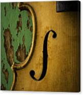 Old Violin Against Green Wall Canvas Print