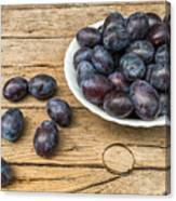 Plate Full Of Fresh Plums On A Wooden Background Canvas Print