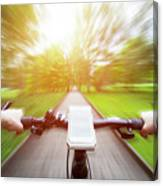 Riding A Bike First Person Perspective. Smartphone On Handlebar. Speed Motion Blur Canvas Print