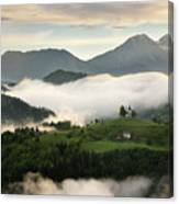 Rolling Fog At Sunrise In The Skofjelosko Hills With St Thomas C Canvas Print