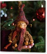 Silly Old Monkey Toy In A Child Hands Under The Christmas Tree Canvas Print