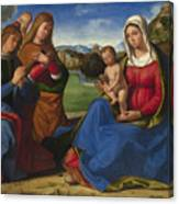 The Virgin And Child Adored By Two Angels Canvas Print