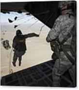 U.s. Airmen Jump From A C-130 Hercules Canvas Print