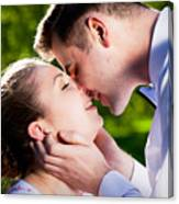 Young Romantic Couple Kissing With Love In Summer Park Canvas Print