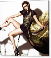 Young Woman In Long Dress On Exercise Bike Canvas Print