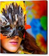Young Woman With A Colorful Feather Carnival Face Mask On Bright Colorful Background Eye Contact Canvas Print