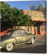 1950 Chevrolet Coupe In Front Of Portal Store Canvas Print