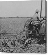 A Farmer Driving A Tractor Canvas Print