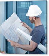 Architect Builder Studying Layout Plan Of The Room Canvas Print