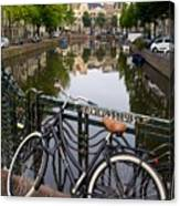 Bicycle Parked At The Bridge In Amsterdam. Netherlands. Europe Canvas Print