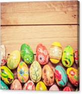 Colorful Hand Painted Easter Eggs On Wood Canvas Print