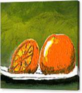 2 Oranges On A White Plate Canvas Print