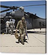 Pararescuemen Walks Away From A Hh-60g Canvas Print