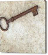 Rusty Key On Old Parchment Canvas Print