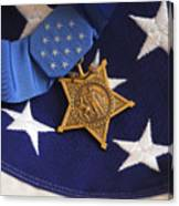 The Medal Of Honor Rests On A Flag Canvas Print