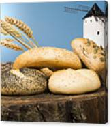 Different Breads And Windmill In The Background Canvas Print