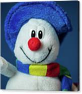 A Cute Little Soft Snowman With A Blue Hat And A Colorful Scarf Canvas Print
