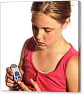 Diabetic Child With Blood Glucose Tester Canvas Print