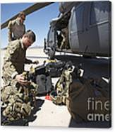 Pararescuemen Sorts Out His Gear Canvas Print