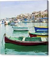 Traditional Boats At Marsaxlokk Harbor In Malta Canvas Print