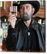 A Bearded Cowboy In Black Contemplates His Whiskey In A Saloon Canvas Print