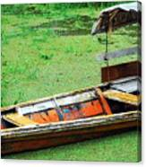 A Boat On Amazon Green Water Canvas Print